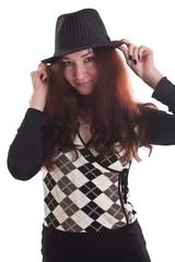 beautiful girl in black hat and dark clothes. studio work