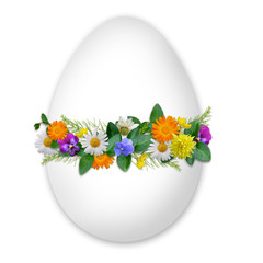 Easter decorated egg with flowers and plants on the white backgr