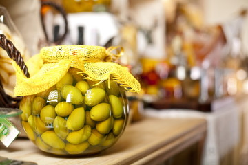 glass jar with green olives