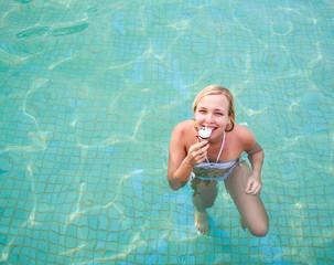Happy woman eating ice cream