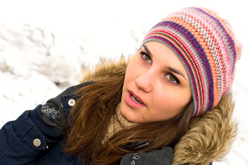 portrait of young woman in colored cap