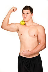 muscle man with green apple