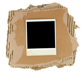 Blank photo card with masking tape on a cardboard