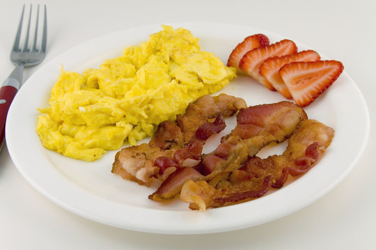 Scrambled eggs with bacon on a plate