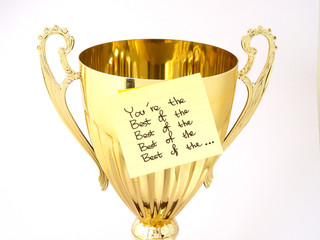 golden cup with post-it written you're the best