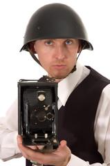 photographer in helmet keeps get old camera