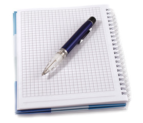 Notebook with blue pen, isolated