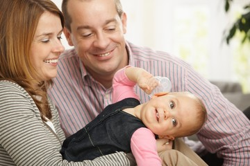 Smiling baby with parents
