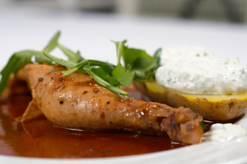 Chicken leg with cream potatoe and sauce