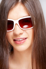 beautiful young girl with fashion sunglasses