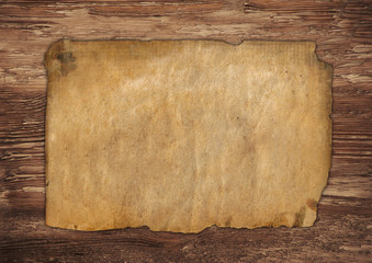 Aged paper on wood