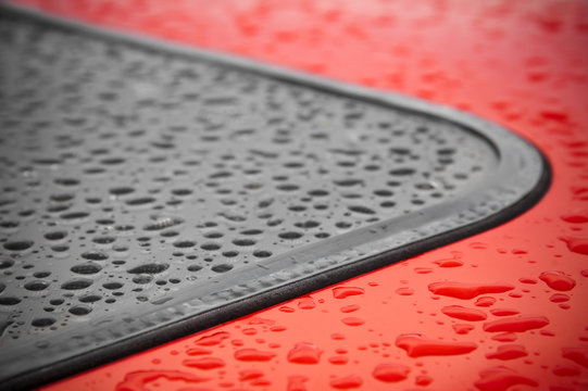 abstract of raindrops around a vehicle window seal