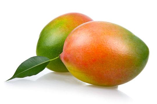 Ripe mango fruits with leaves isolated