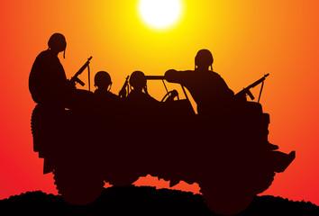 Keuken foto achterwand Militair Marines. Silhouette of soldiers on the vehicle