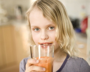 Girl with carrot juice