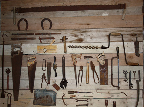 Old hand tools on a workshop wall