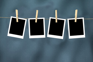Four empty photos hanging from clothesline with clipping path