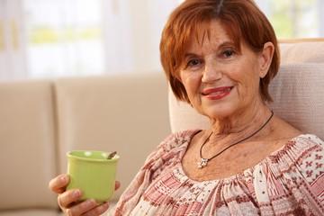 Portrait of senior woman drinking coffee
