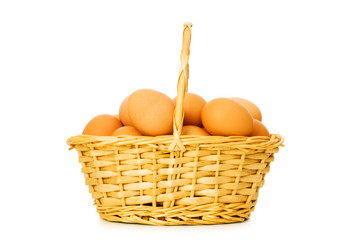 Basket full of eggs isolated on white