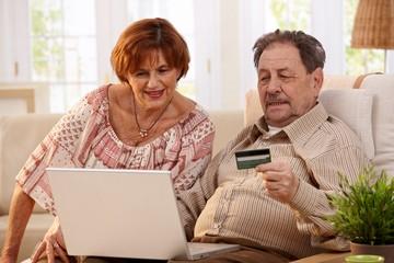 Elderly couple shopping online