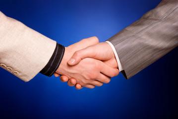 hand shake on blue