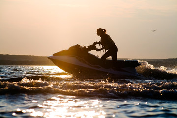 Foto op Canvas Water Motor sporten beautiful girl riding her jet skis