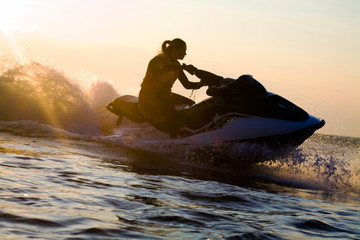 Fotorolgordijn Water Motor sporten beautiful girl riding her jet skis