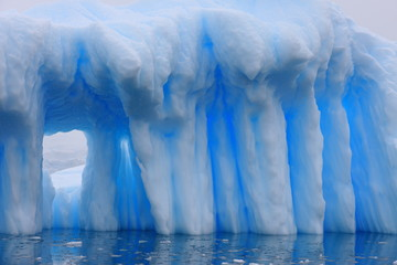 Iceberg and azure water in Antarctica
