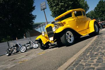 Fototapeta classic yellow hotrod and custom motorbikes obraz