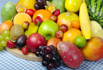 Exotic Fruit Mix on Wooden Board and Tablecloth