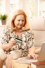 Elderly woman shopping on internet