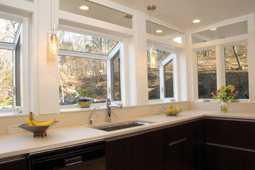 kitchen countertop with windows over it