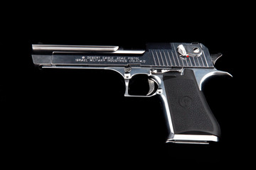 A gun Desert Eagle on a black background