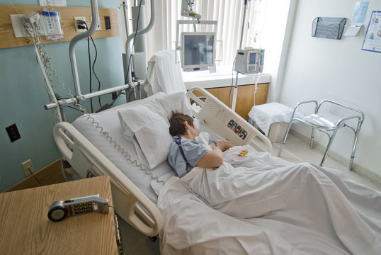 Patient recuperating from surgery in hospital room
