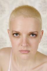portrait of short hair blond serious woman