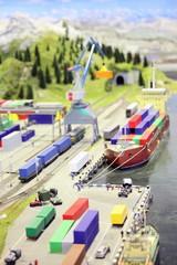 model of railroad station and sea port. ship, railroad, train.