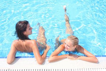 enjoying the sun in a swimming pool