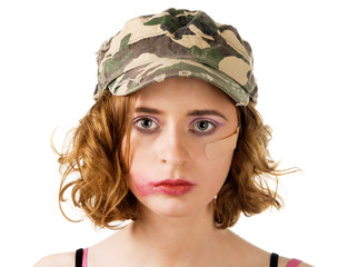 Young woman with smudged makeup an plaster on cheek