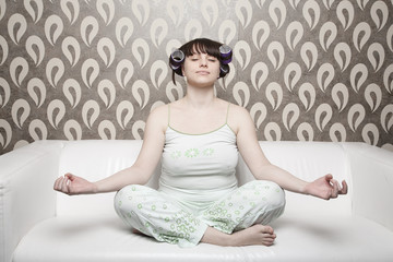 young adult girl on white sofa relax with yoga exercise