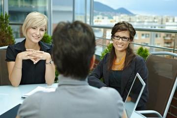 Businesswomen talking on terrace