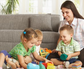 Mother playing with children at home