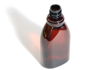 Brown plastic bottle on white background