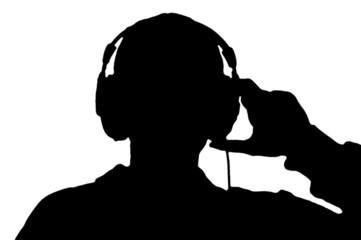 boy in headphone silhouette