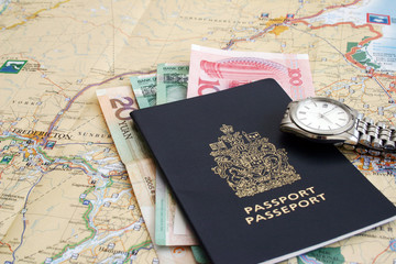 Passport , lots of money , steel watch, and a map.