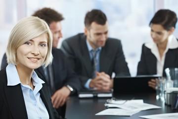 Smiling businesswoman portrait at meeting