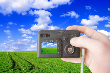 Green field and camera conceptual image.
