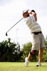 Golfer with knee brace.