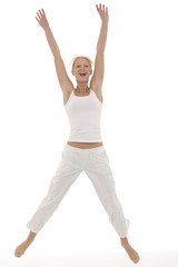 young beautyful caucasian woman in sportswear jumping