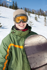 Happy smiling snowboarder