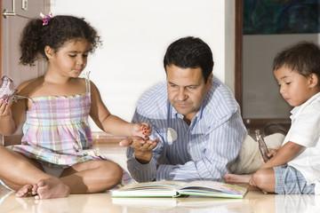 Dad teaching children